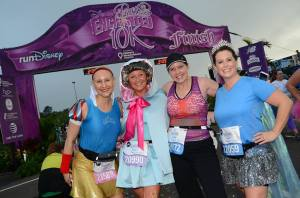 Kimberly, Gail, Rebecca, and Pam at the finish of the 2014 Enchanted 10K [this photo made the runDisney official race photo album]