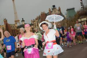 Sleeping Beauty and Mary Poppins run through Epcot during the 2014 Walt Disney World Enchanted 10K.