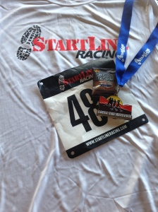 Race shirt and medal from my DNF-ish performance.