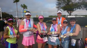 Finishers of the 2014 Glass Slipper Challenge (and the special pink Coast to Coast medal for running Disneyland Tinker Bell Half Marathon Weekend races AND Walt Disney World Princess Half Marathon races in the same calendar year).