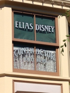 Walt Disney's Main Street, U.S.A dedication window to his father, Ellias Disney.  Look up at the Emporium.