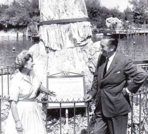 Lillian and Walt Disney in front of the petrified tree he bought her for their anniversary.